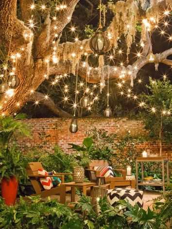 Patio Ideas String Lights In Trees Lanterns Lamps Mason Jars Christmas Lights in Trees Chevron Pillows on Brown Porch Chairs