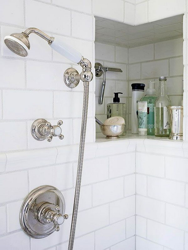 This shower niche wraps around a corner for a bit of extra room for shampoos, soaps, a razor, and other necessities.