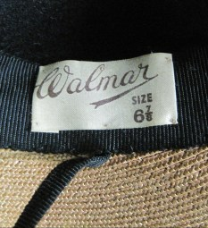 Walmar label, featuring the size - 6⅞. The bottom of the photo shows the straw foundation of the hat.