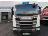 White Scania vehicle outside a warehouse with KDG logo