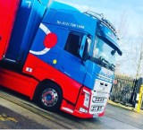 Onpoint Logistics iconic red and blue vehicle