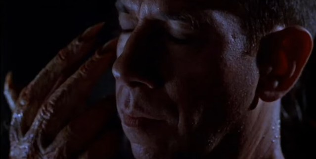 A still shot taken from the 1997 horror film 'The Night Flier'. It shows a man with a monstrous hand caressing his face.  5 Lesser-Known Stephen King Adaptations.