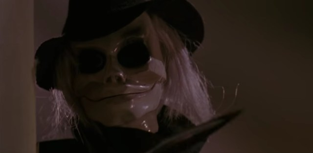 A screen shot taken from the 1989 horror film 'Puppet Master'. It shows a close-up of the skull-faced puppet, Blade.  Top 5 Films Featuring Killer Dolls