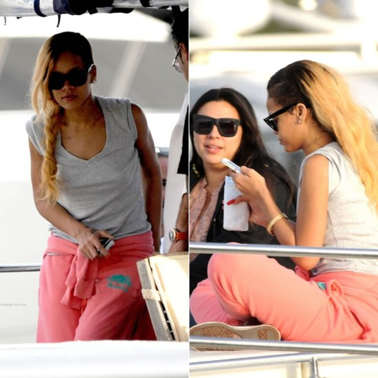 Rihanna on a yacht in Turkey wearing Roots sweatshirt and sweatpants in Summer Coral, Converse high-top sneakers and Ray-Ban Wayfarer sunglasses