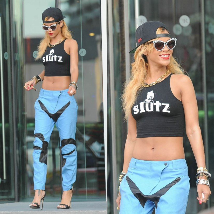 Rihanna in MadeMe Slutz crop top, rag & bone blue moto pants, Rihanna for River Island barely there stiletto sandals, Zanzan Erzulie sunglasses, Lynn Ban cross charm bracelet, Balenciaga giant stud leather braclet, Fallon spike rings