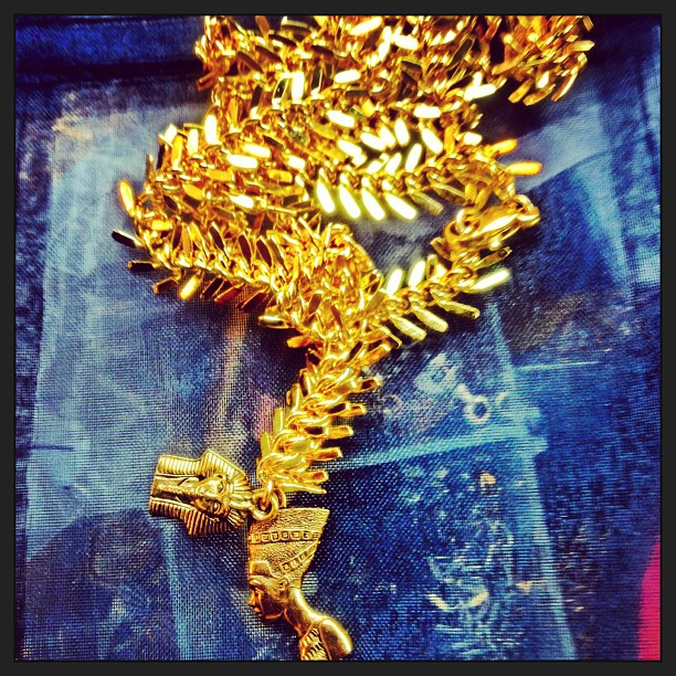 Kayode Co. gold necklace with King Tut and Nefertiti charms