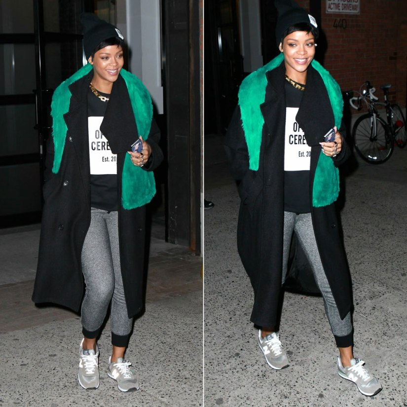 Rihanna in Opening Ceremony logo patch beanie and t-shirt, New Balance 574 sneakers, Alexandre Plokhov drape back coat