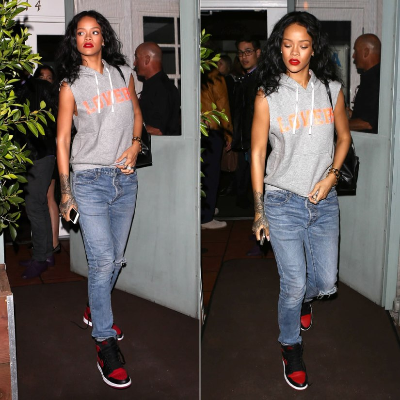 Rihanna wearing Lovers + Friends Afternoon hoodie, Air Jordan 1 Retro mid sneakers, Balmain Homme distressed jeans, Stella McCartney Beckett backpack, Lynn Ban skull ring, Fallon rings
