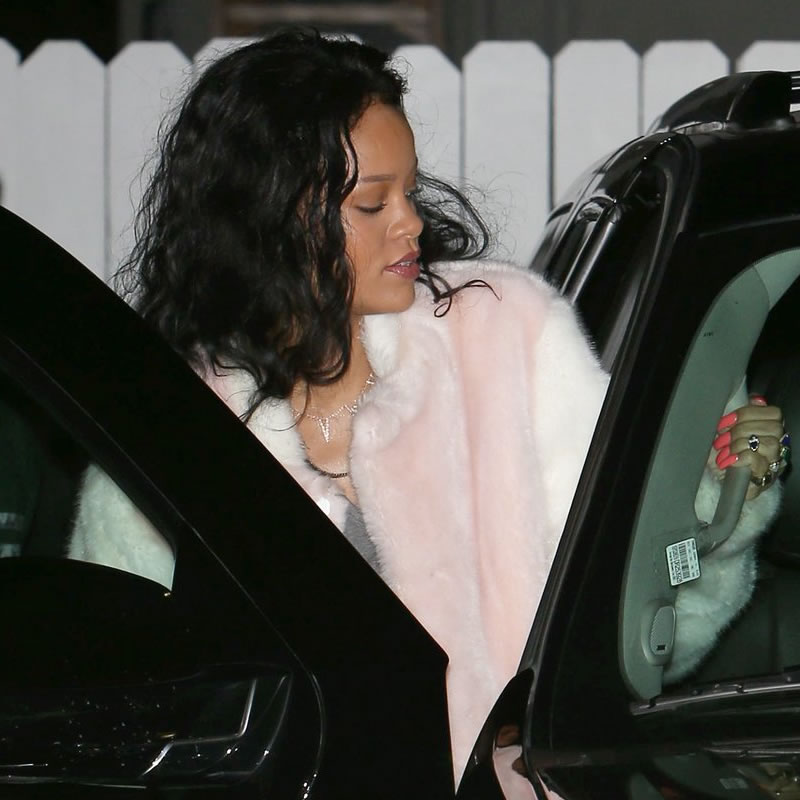 Rihanna wearing pink and white faux fur jacket by Adam Selman