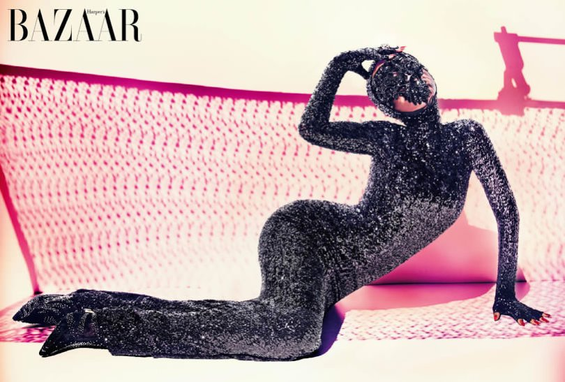 Rihanna wearing Michael Cinco couture sequined hooded gown in Harper's Bazaar Arabia July 2014