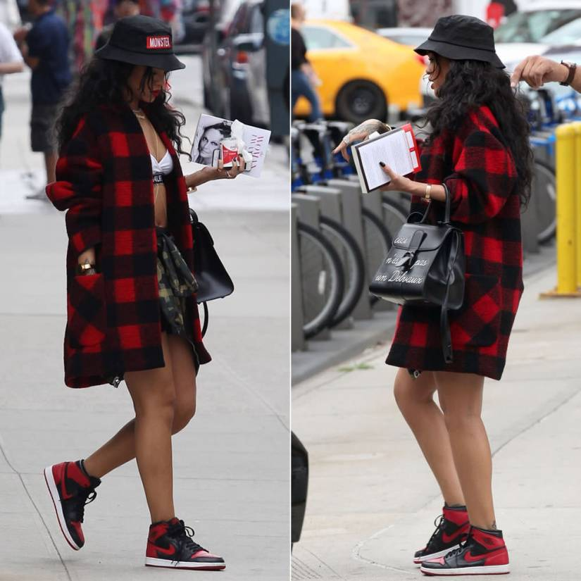 Rihanna wearing Isabel Marant Etoile red checked jacket, Air Jordan 1 sneakers, Trapstar Monster bucket hat, Delvaux ceci n'est pas un Delvaux Brillant handbag, Rihanna for River Island g4life white bralet, Bape camo jacket