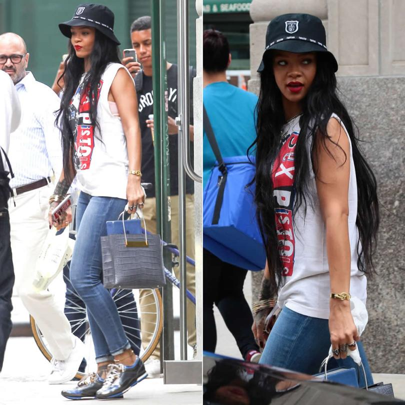 Rihanna in Trapstar black bucket hat, Sex Pistols white t-shirt, J Brand 620 distressed skinny jeans, Lanvin holographic sneakers, Balenciaga croc-embossed tote with cable straps, Jennifer Fisher double snake cuff