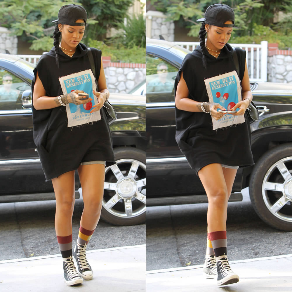 eb3f0564e38d Rihanna was photographed out and about Los Angeles yesterday. The Barbadian  songstress was spotted posing with fans and hanging out with music royalty  like ...