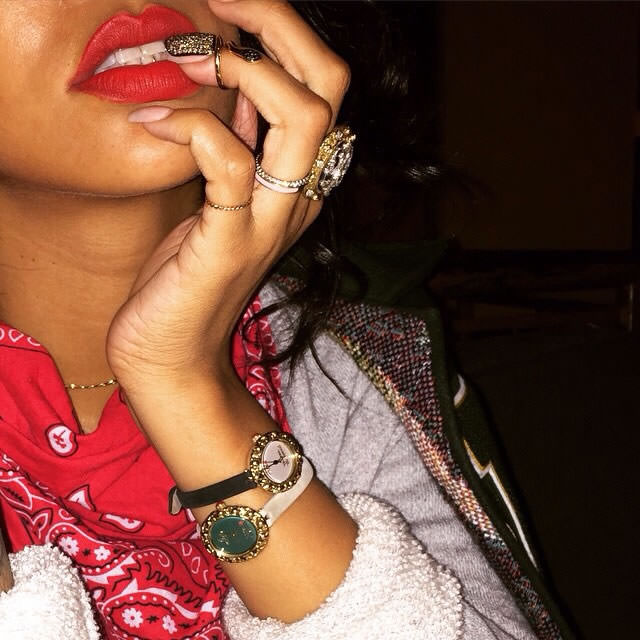 Rihanna wearing Bijules gold snake nail ring and Vivienne Westwood leather watches