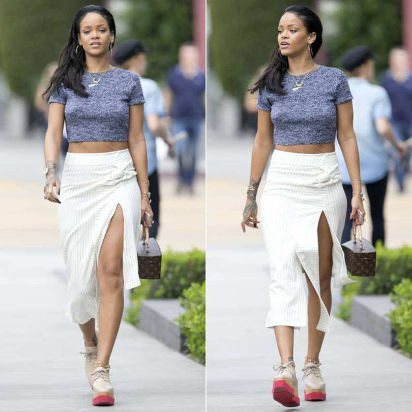 Rihanna wearing alice + oliva Solange grey herringbone crop top, J.W.Anderson pinstriped asymmetrical skirt, Stella McCartney Britt platform shoes, Louis Vuitton by Frank Gehry Twisted Box bag, Jacquie Aiche diamond hoop earrings, emerald necklaces, gemstone cuffs and rings
