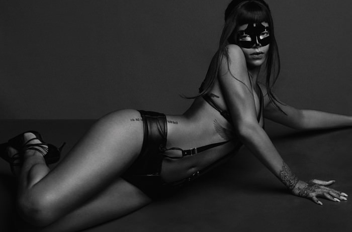 Rihanna wearing Alexander McQueen mask, Katy England studio suspenders, Agent Provocateur leather briefs in AnOther magazine