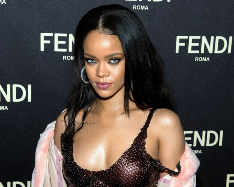 Rihanna at Fendi Madison store opening in vintage Fendi dress and pink fur coat
