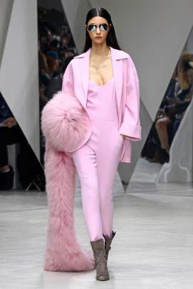 Pascal Millet Fall 2015 pink jacket, stirrup jumpsuit and boa as seen on Rihanna