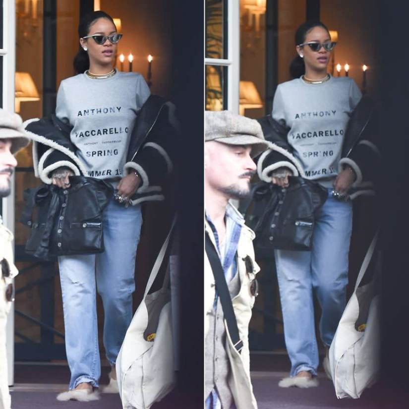 Rihanna wearing Adam Selman x Le Specs The Hunger silver cat eye sunglasses, Anthony Vaccarello printed grey sweatshirt, Dsquared2 Fall 2015 shearling trim jacket, Simone Rocha feather trim mule sandals, Chanel black Girl handbag, Dylanlex rings