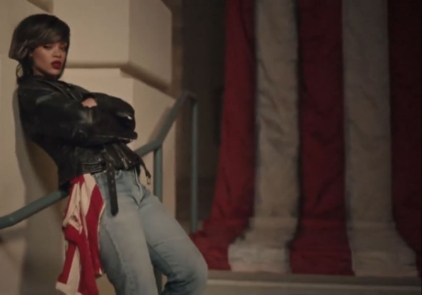 Rihanna wearing Schott NYC Perfecto leather jacket, WGACA vintage jeans, Chapel NYC US flag in American Oxygen music video