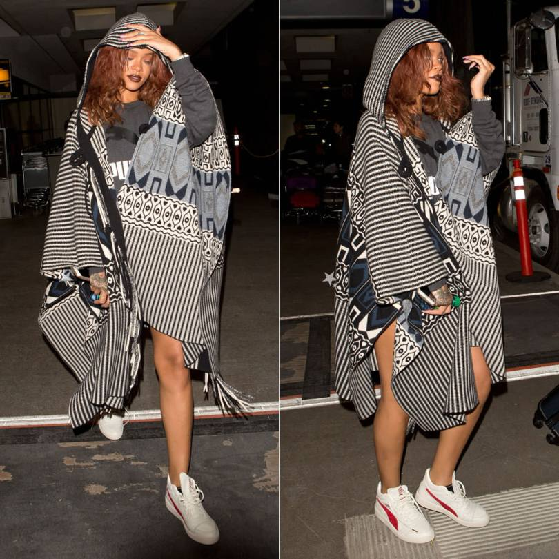 Rihanna wearing Chloe pre-fall 2015 fringed poncho, Puma No. 1 Large logo sweatshirt, Puma Boris Becker OG white and red sneakers, Unearthen crystal pyramid watch