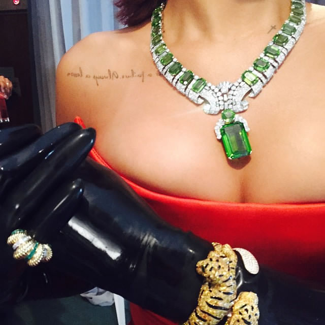 Rihanna wearing Cartier emerald necklace and tiger bracelets at the 2015 Met Gala