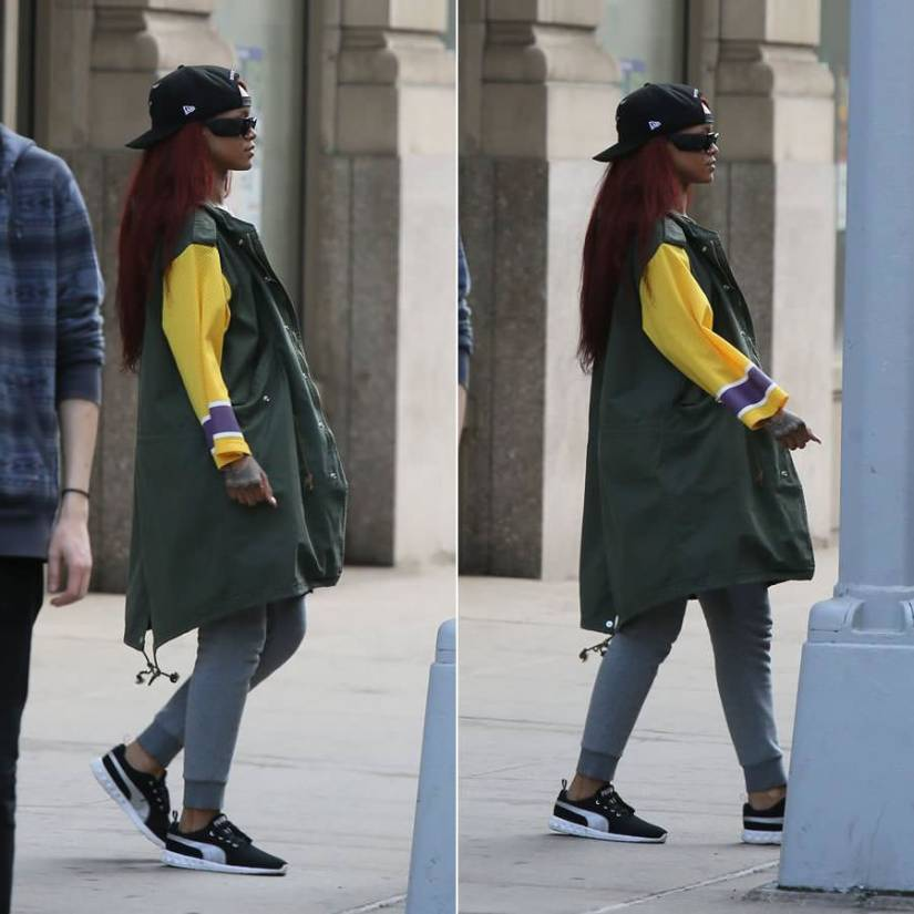 Rihanna wearing Roc Nation New Era snapback cap, Phenomenon hockey sleeve parka coat, Puma cargo sweatpants, Puma Carson running shoes, Chanel quilted leather sunglasses