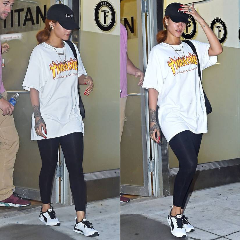 Rihanna wearing 40oz van studios snapback cap, Thrasher magazine flame logo t-shirt, Puma Pulse XT Geo training shoes
