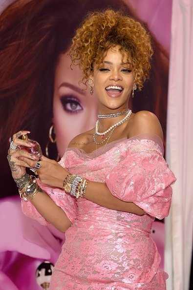 Rihanna wearing Vivienne Westwood Red Label and Christian Louboutin at RiRi perfume launch