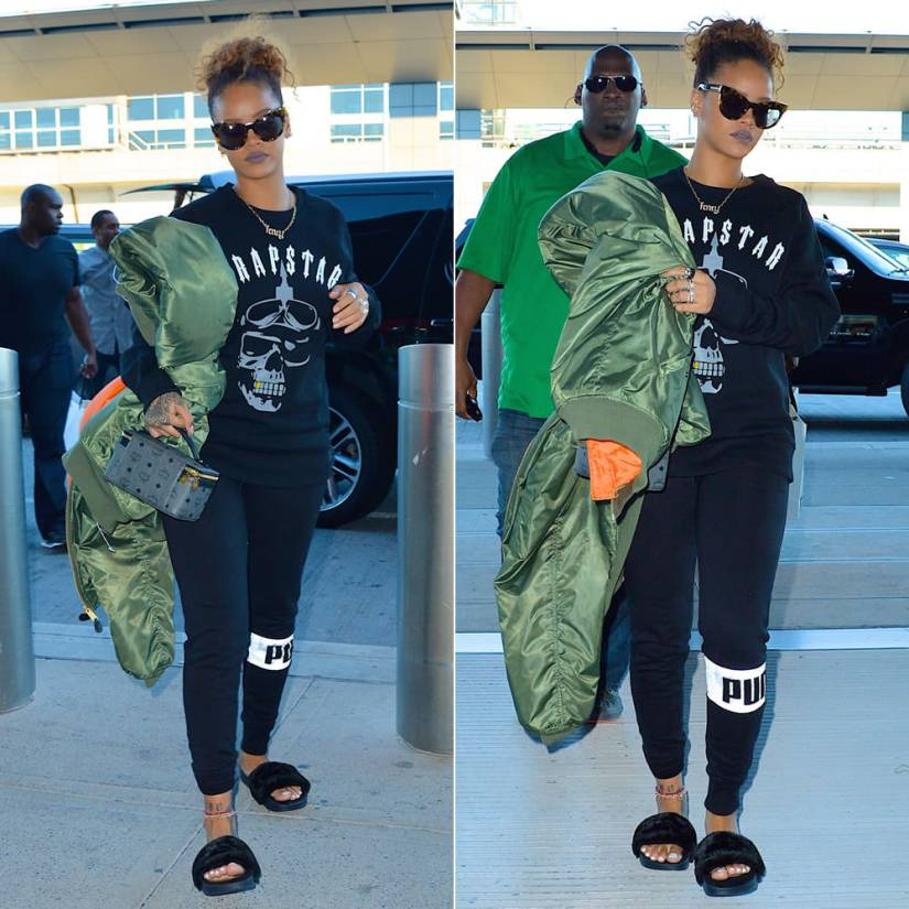 Rihanna wearing Karen Walker Starburst tortoise cat-eye sunglasses, Trapstar Shadow Riders sweatshirt, Puma sweatpants and fur slides, Vetements oversized bomber jacket