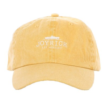 Joyrich iconic logo cap in yellow as seen on Rihanna