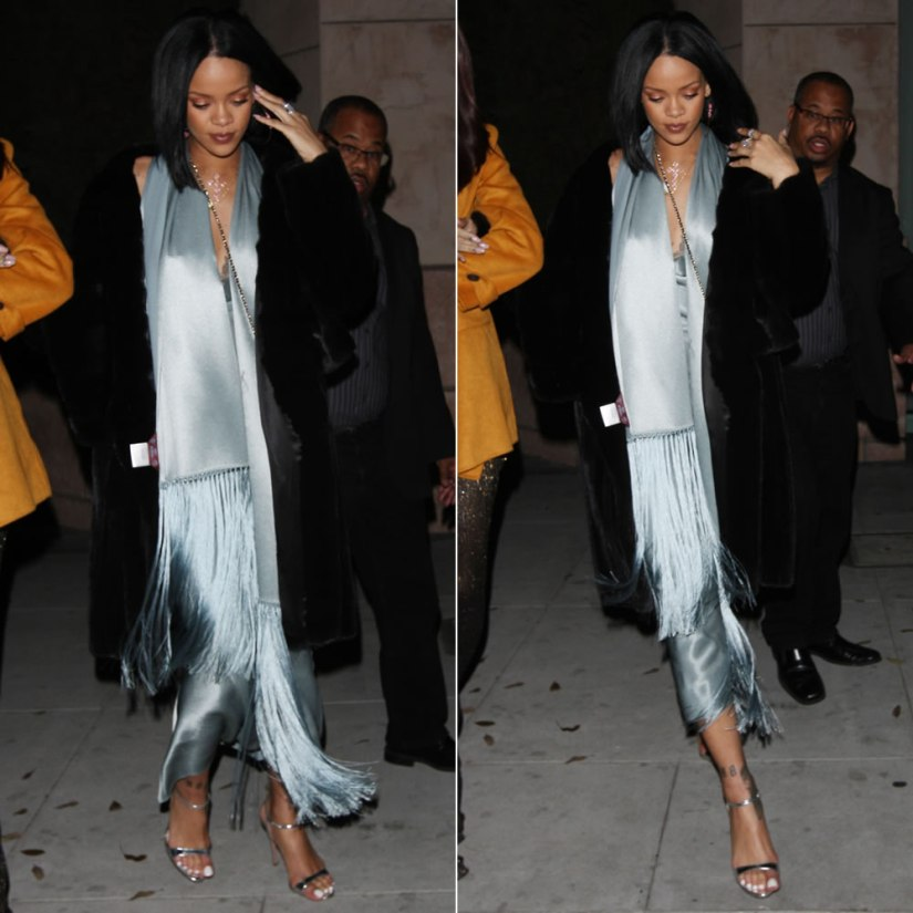 Rihanna vintage John Galliano silver dress with fringed scarf, Prada silver sandals, Chanel chain handle glasses case, Jacquie Aiche diamond bra, cross necklace and hoop earrings