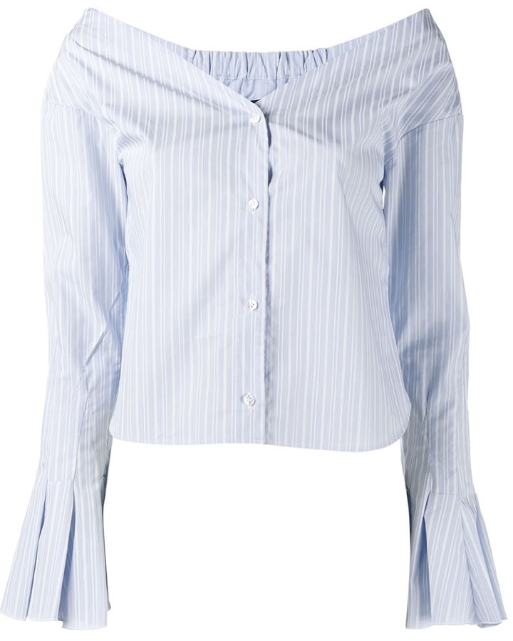 a31beb301d The trendsetting singer rocked a blue and white striped top by Jacquemus.  The poplin top is an off-the-shoulder design with a v neckline, a button  front ...