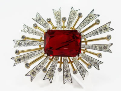 Kenneth Jay Lane starburst brooch as seen on Rihanna