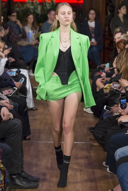 Vetements green oversized blazer and mini skirt as seen on Rihanna