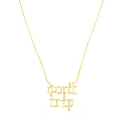 Huckleberry Ltd Don't Trip pave diamond and yellow gold necklace as seen on Rihanna