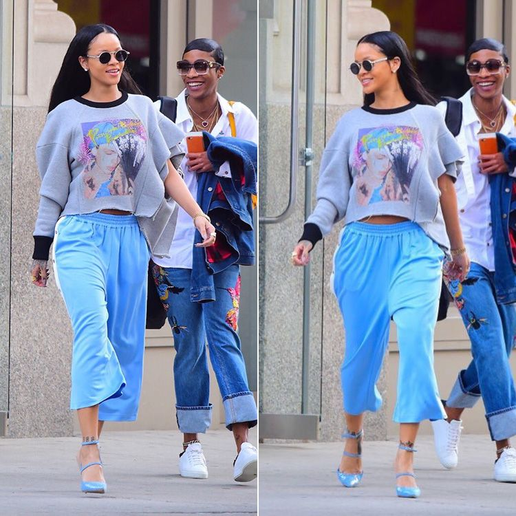 Rihanna Maison Margiela one sleeve graphic sweatshirt and blue side stripe cropped track pants, Manolo Blahnik Sea Salts sequin denim pumps, Jean Paul Gaultier vintage 56-8171 sunglasses