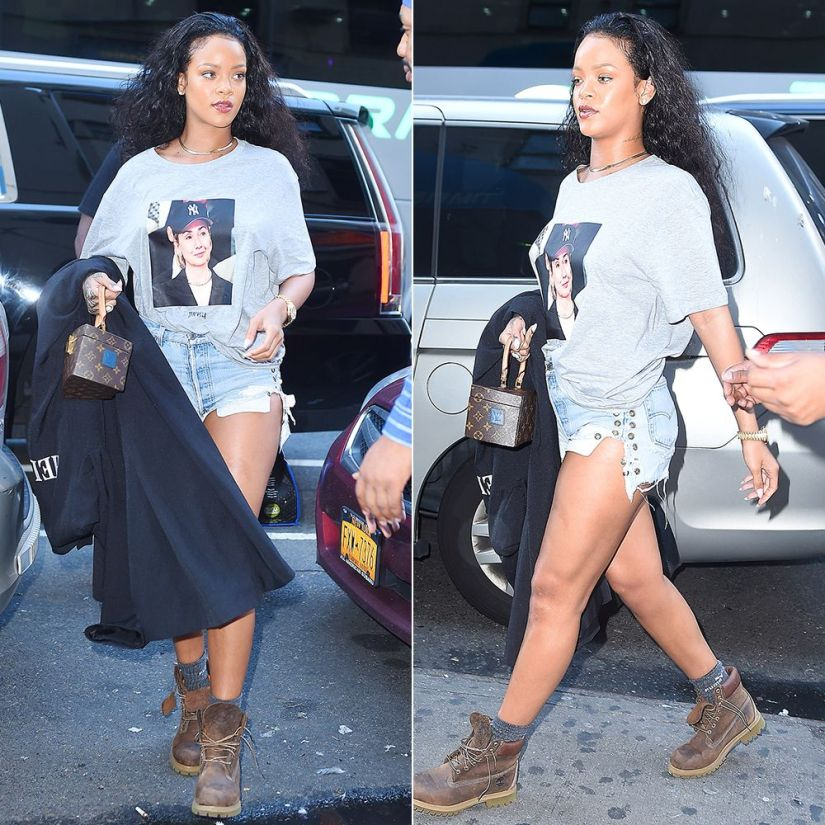 Rihanna Trapvilla Hillary Clinton tee, Levi's grommet shorts, Puma crew socks, Timberland brown burnished waterproof boots, Louis Vuitton Twisted Box handbag, Vetements Hello Boys black floor-length coat