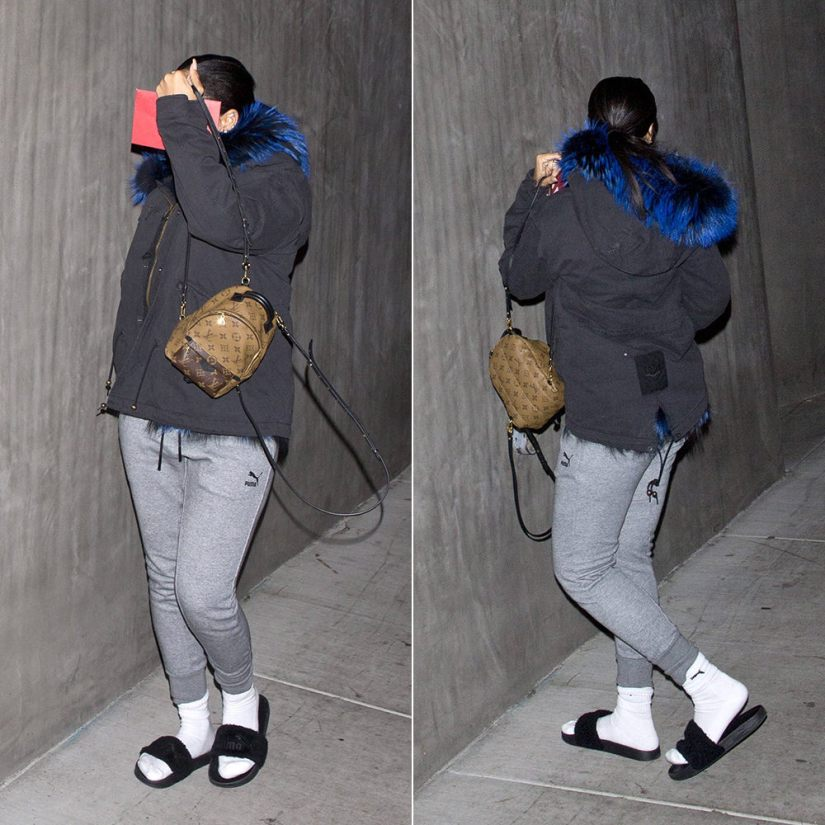 Rihanna Mr Mrs Italy blue fur parka jacket, Puma grey sweatpants, white crew socks and Fenty x Puma black fur slides, Louis Vuitton Palm Springs Mini backpack