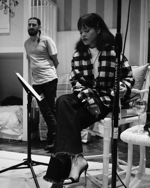 Rihanna Vetements plaid shirt black white, Matthew Adams Dolan frayed jeans, Manolo Blahnik Chaos sandals