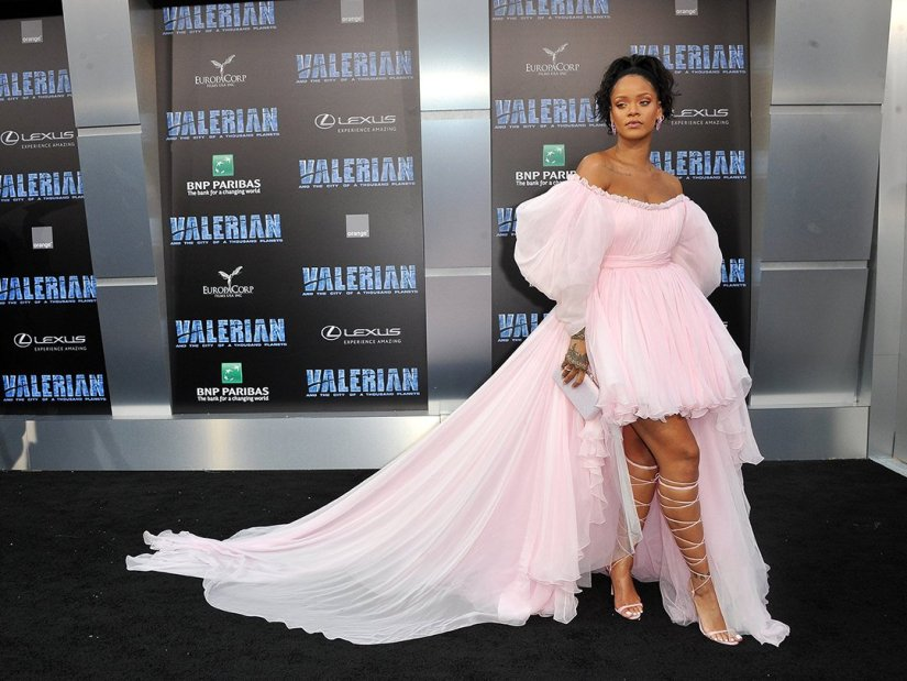 Rihanna Valerian premiere Giambattista Valli dress, Manolo Blahnik lace-up sandals, Judith Leiber slim slide clutch, Chopard earrings and watch, XIV Karats bracelet