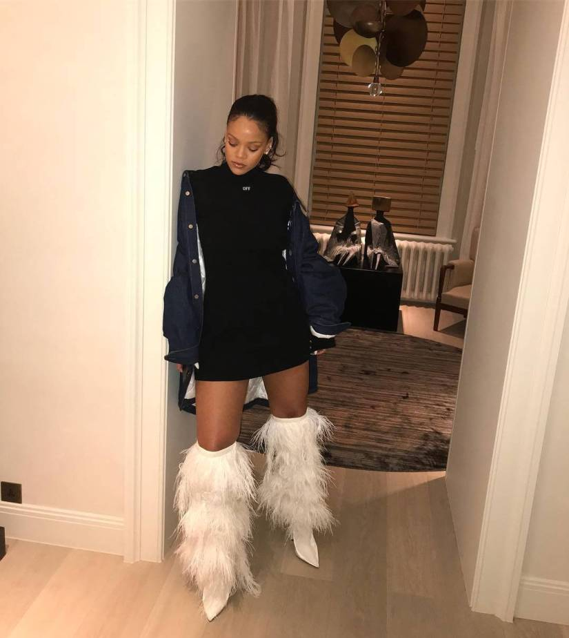 Rihanna Saint Laurent feather fringe white boots Spring 2018, Off-White Angel Sexy mock neck mini dress, Raf Simons denim shirt jacket