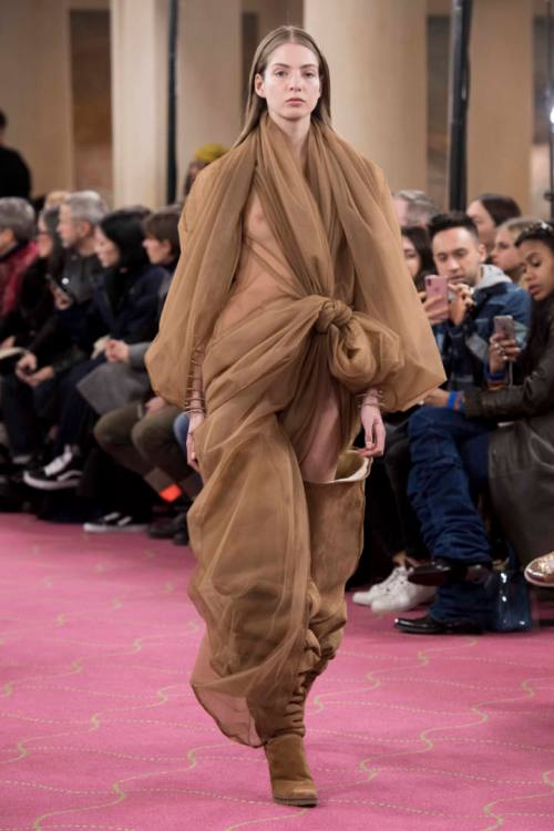 Y/Project Fall 2018 sheer brown organza tulle dress and UGG thigh high XL boots as seen on Rihanna