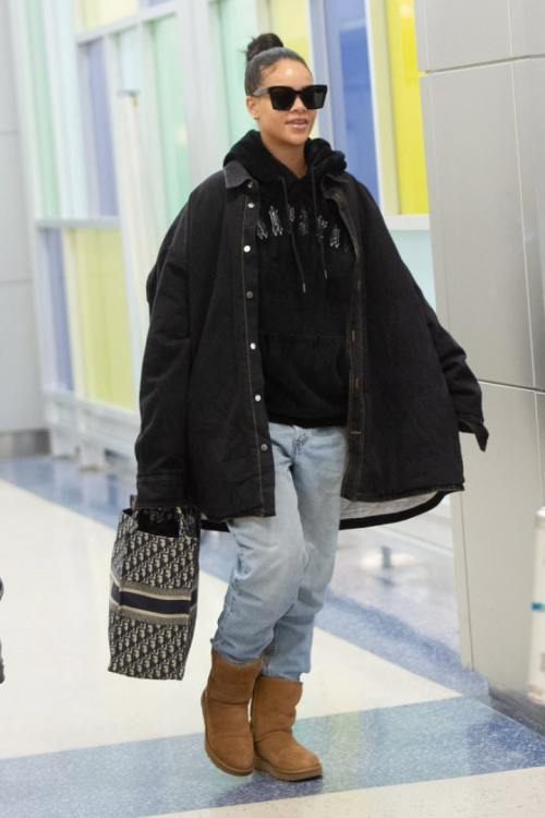 Rihanna black Trapstar fleece hoodie Irongate, Raf Simons denim shirt jacket, Dior book tote, UGG classic short boots, Off-White x Warby Parker sunglasses