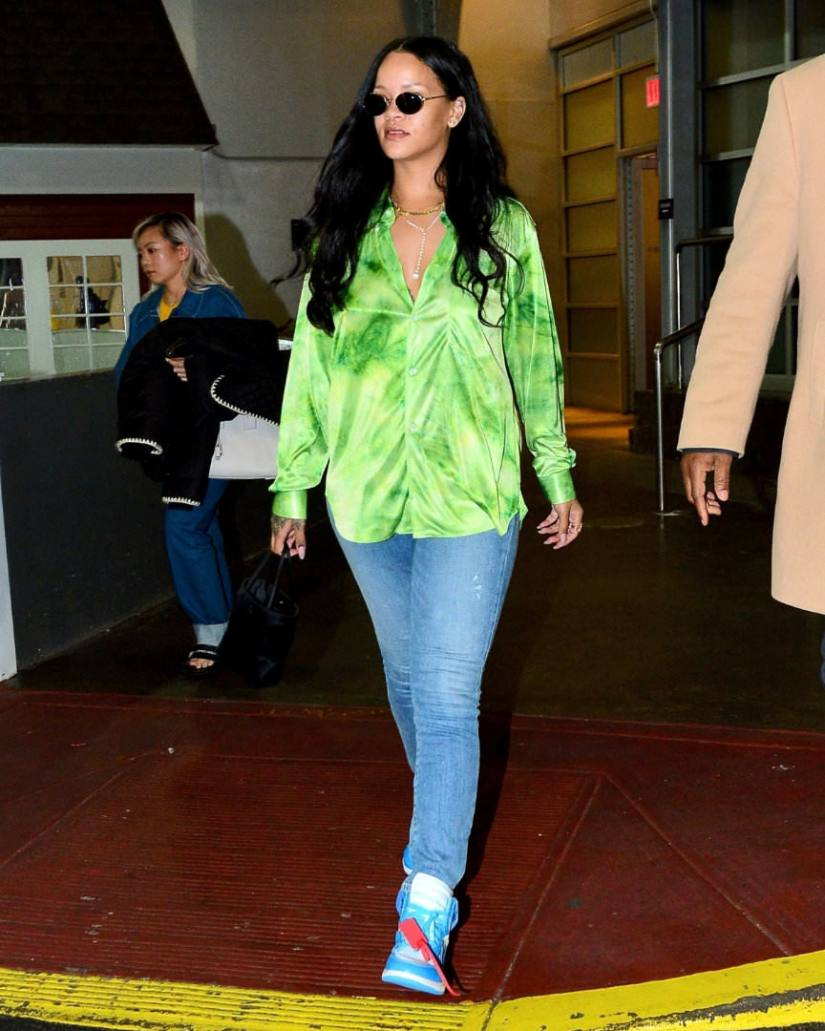 Rihanna green tie-dye shirt comme des garcons, Citizens of Humanity Rocket distressed jeans, Off-White x Nike Air Jordan 1 UNC powder blue sneakers, dior vintage sunglasses, XIV Karats yellow diamond necklace