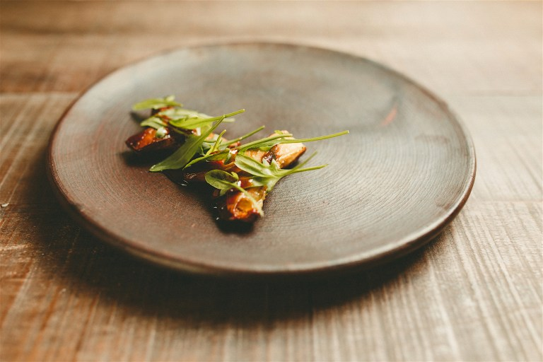 Raw pine mushrooms, burnt mushroom sauce and sheep sorrel by Diego Prado.