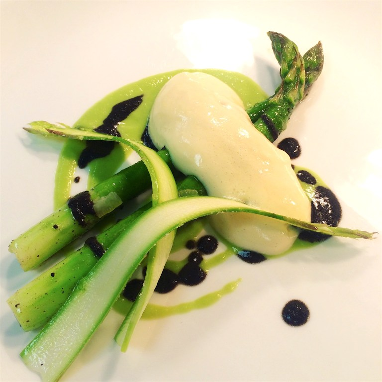 Pertuis asparagus with a buerre noisette and vin jaune hollandaise, confit lemon and hazelnuts by Tom Kemble