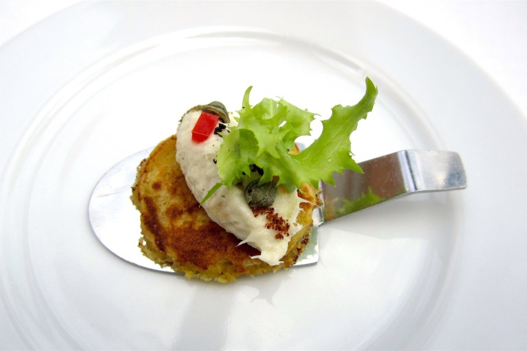 Corn pancake with creamed cod - close up