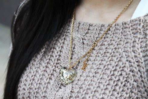 An Dyer in Chunky Oversized Cable Knit Sweater, Transparent Monogram Inclusion Translucide Pendant Necklace