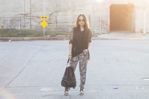 An Dyer wearing Chaser Brand Bronze Chain Mail chainmaille cardigan & cut out slit tank top, Lavishville High Waisted Animal Print Pants, Mojo 15W Convirtible Waxed Coated Canvas Backpack, Vaunt Leopard Etched Aviators, Sole Society Dawn Sandals, Glint & Gleam Zipper Bangle ShopLately